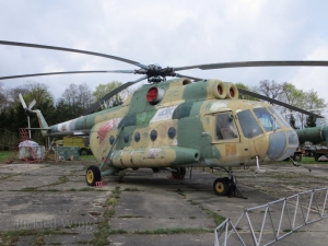 A Mil Mi-8 transport helicopter; faded but firm.
