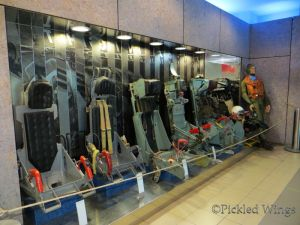 A display of ejection seats from different eras.
