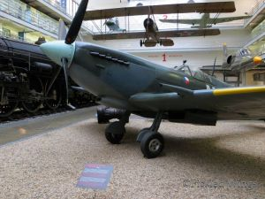 A Spitfire fighter and other aircraft in the museum's transportation hall.