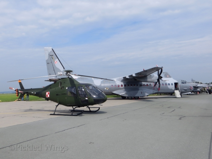 A PZL SW-4 helicopter, a CASA 295 transport and an F-16 fighter in from Poland.