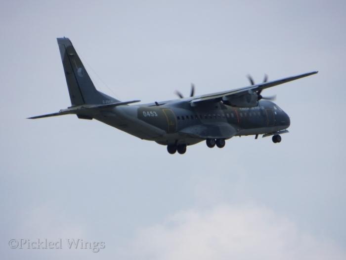 A Czech CASA 295 transport pulls up from a touch-and-go landing.